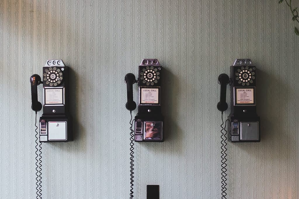 old rotation phones on wall